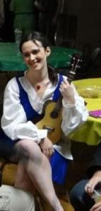 Belle playing the uke?  Another picture that proves I'm doing it right.